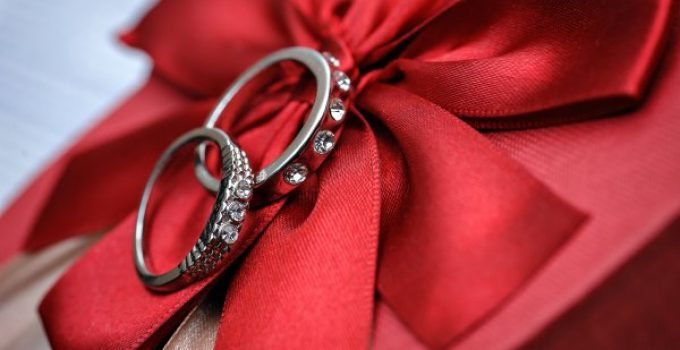 silver rings on red ribbon