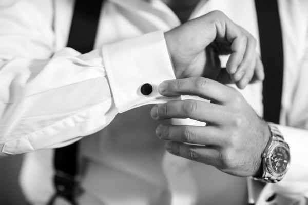 groom wears cufflinks