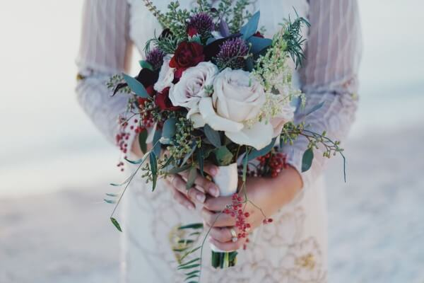 bride with wedding ring and flowers